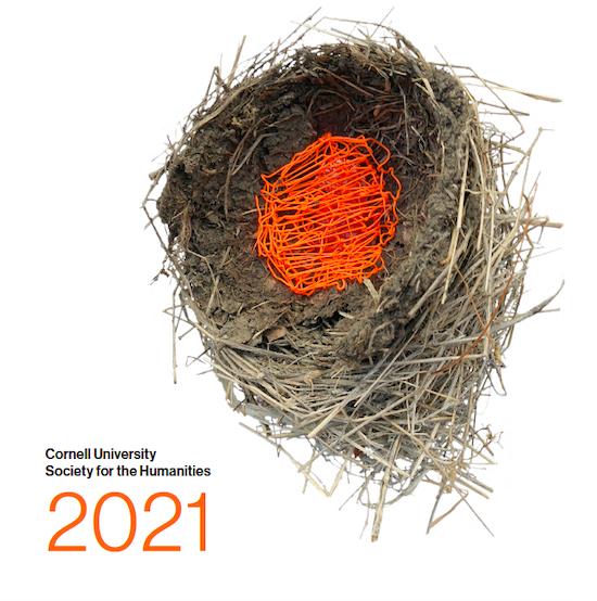 Nest artwork with orange yarn woven through branches
