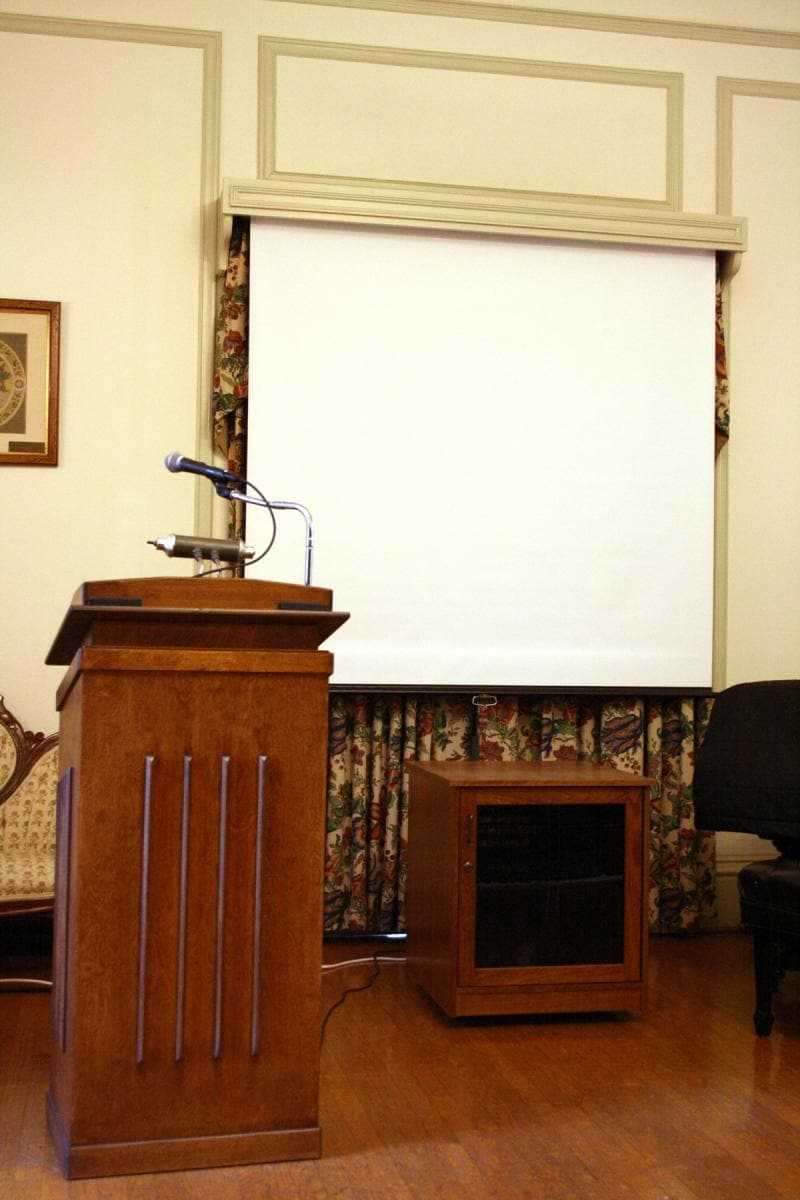 Podium and projector set up for lecture.
