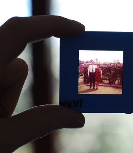 fingers holding photo of an elderly couple